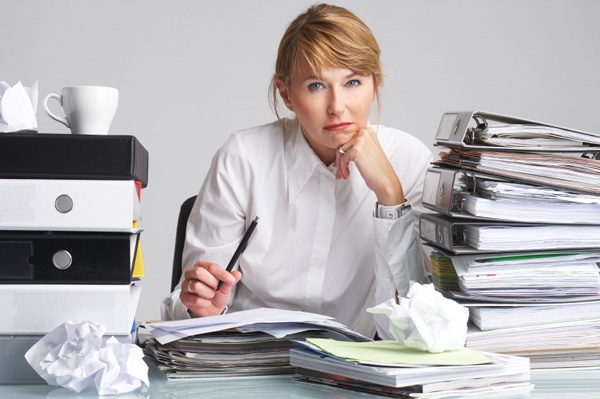 stressed_woman_at_work_paperwork